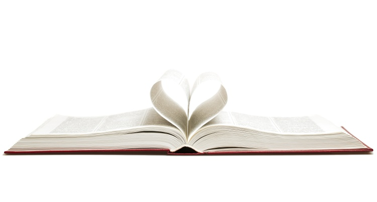Opened book with heart